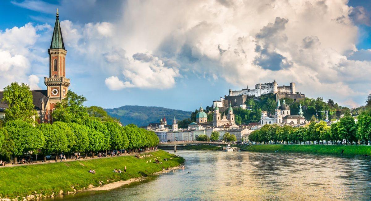 Beautiful view of Salzburg skyline with Festung Hohensalzburg and Salzach river in summer, Salzburg, Salzburger Land, Austria-min